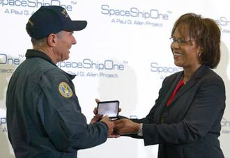 Commercial astronaut - Patricia G. Smith, Associate Administrator for Commercial Space Transportation at the FAA, presents SpaceShipOne pilot Michael Melvill the department's first commercial astronaut wings