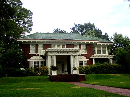 Pine Wold house (Fairfield Avenue at Kirby Street) was designed by Edward F. Neild, who created some of the designs for the interior of the White House in the Truman administration, as well as the Harry S. Truman Presidential Library and Museum. Pine Wold was constructed in 1903 by lumberman T. J. Jones and expanded in 1919 by oilman J. P. Evans. For a time the Mighty Haag Circus wintered on the grounds, and the circus elephant Trilby is buried there. Pine Wold house, Shreveport, LA IMG 4951.JPG