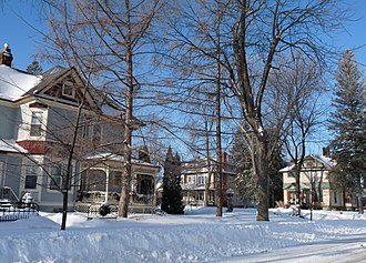 Eli Winch - The house at left is Eli Winch's home in Marshfield, built in 1897.