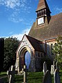 Porch and clock at St Mary's Church, West Dean - geograph.org.uk - 356071.jpg