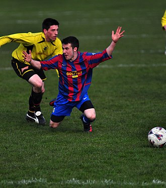 Diving (association football) - The raised arms and look at the referee indicate a possible dive.