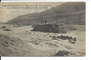 Cape Cod Canal - A postcard view of the July 4, 1914 breaking of the dam that separated the two rivers