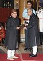 Pranab Mukherjee presenting the Sangeet Natak Akademi Award-2013 to Shri Hashmat Ali Khan, in the field of Hindustani Instrumental Tabla.jpg