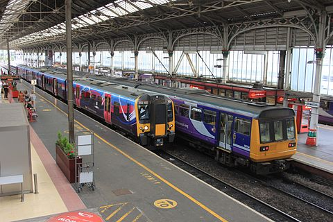 Trains from Northern and TransPennine Express at Preston Preston - FTPE 350403 and Northern 142058.JPG