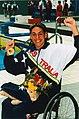 Priya Cooper gold medal in chair fist pump.jpg