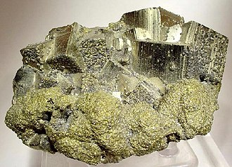 Chalcopyrite - Brass-yellow chalcopyrite crystals below large striated pyrite cubes