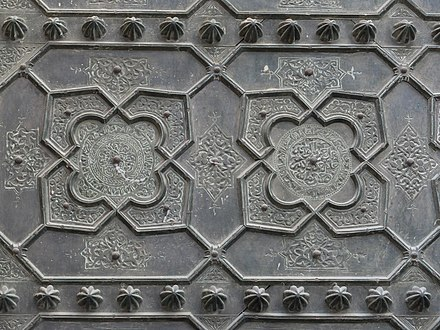 Detail of the Almoravid-era bronze overlays on the doors of al-Qarawiyiin's Bab al-Gna'iz. Qarawiyyin Bab al-Ganaiz 02.jpg
