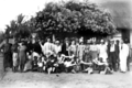 Queensland State Archives 5740 Hon J C Peterson Home Secretary and party with residents of Badu Torres Strait Island June 1931.png