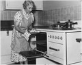 "REA, ""Eldery lady removes pie from oven"" - NARA - 195874.tif"
