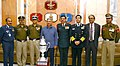 Rao Inderjit Singh in a group photograph with the officers of the Border Security Force who received the Republic Day Trophy for Best Marching Contingent, in New Delhi.jpg