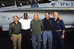 Rear Adm. James D. McArthur Jr. (right) and Capt. David L. Logsdon (far left) pose for photographs with James Brown, Terry Bradshaw and Howie Long upon their arrival on board USS Harry S. Truman (CVN 75).jpg
