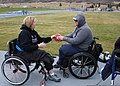 Retired U.S. Navy Master-at-Arms Seaman Steve Hancock, right, a Navy-Coast Guard team member, shares a discus with a British wounded warrior during practice in preparation for the 2013 Warrior Games in Colorado 130509-N-DT940-241.jpg
