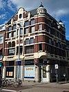 foto van Woonwinkelpand met lagere annex
