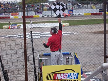 The Mid American Stock Car Series flagman wavi...