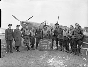 John A. Kent - No. 92 Squadron pilots celebrating their 130th victory; Squadron Leader Kent in centre.