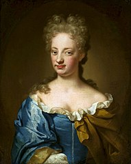 Portrait of a young lady in blue dress.