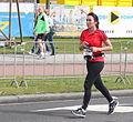 Running marathon woman with black hair.JPG