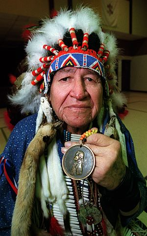 Corps of Discovery - A member of Oglala Sioux with one of the original Indian Peace Medals that were given out by the Lewis and Clark Expedition to Native American leaders between 1804 and 1806