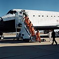 STS-31 crew egresses Discovery, OV-103, via stairway after Edwards landing.jpg