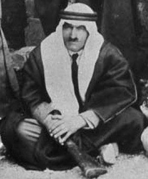 Sa'id al-'As - Al-'As seated with his rifle, 1925