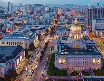 San Francisco City Hall as seen from 100 Van Ness at dusk (cropped).jpg