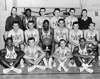 San Francisco Dons men's basketball - The 1956 team that won the NCAA championship. Bill Russell (centre) is holding the ball.