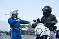 Saori Takehana, left, a Kanagawa motorcycle police trooper, talks to U.S. Navy Aviation Electrician's Mate 1st Class Michael Kirsch during Shirobai training in Yokohama, Japan, May 24, 2013 130524-D-OJ170-347.jpg