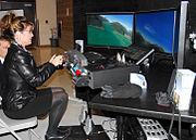 Governor Palin testing a flight simulator at Alaska National Guard Headquarters, Fort Richardson
