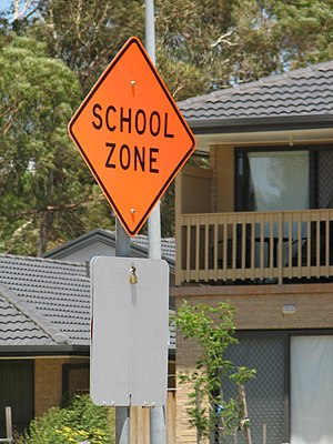 School zone - An Australian school zone sign, covered during school holidays, to denote the use of normal speeds