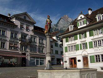 Schwyz - Fountain in the central plaza in Schwyz