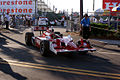 Scott Dixon Towed Back After Morning Practice close GPSP 27March2011 (14512892550).jpg
