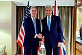 Secretary Kerry Shakes Hands With British Foreign Secretary Hammond Before Working Breakfast in London (24517805073).jpg