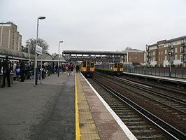 Silverlink 313122 and 313123 at Kensington Olympia 02.jpg