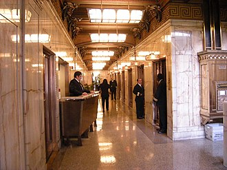 Elevator operator - The Smith Tower in Seattle, Washington uses traditional elevator operators, as seen in this 2008 photo