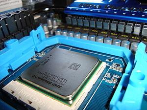 Phenom II - An AM3 socket with an inserted AMD Phenom II X3 720 Black Edition CPU.