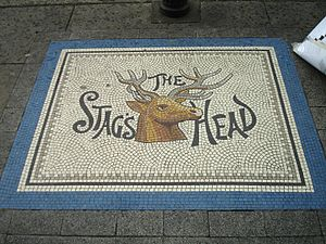 Mosaic outside alley leading to Stag's Head Pu...