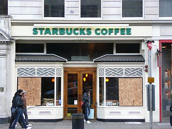 A boarded up Starbucks in Piccadilly, London, ...