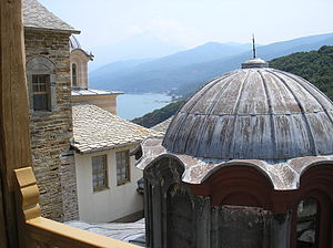 Stavronikita - Sight of the interior of the monastery. In the background Mount Athos, the highest mountain of the peninsula