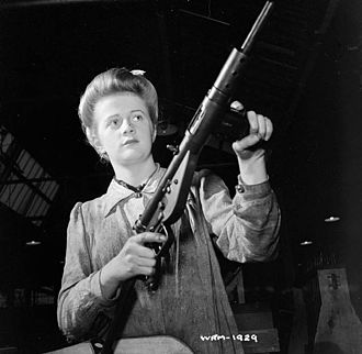 Sten - Worker posing with a Sten Mk II in the factory on 26 May 1942.