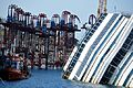 Strand Jacks mounted on the Tops of the Retaining Turrets and the Costa Concordia wreck - Isola del Giglio - Italy - 18 Aug. 2013.jpg