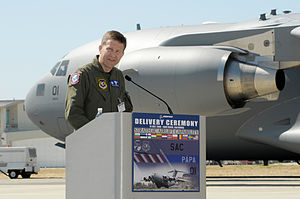 Strategic Airlift Capability - Col. John Zazworsky addresses the audience after officially receiving the first of three C-17 Globemaster IIIs to be acquired by the 12-nation Strategic Airlift Capability Program on 14 July 2009 at Long Beach, California, United States