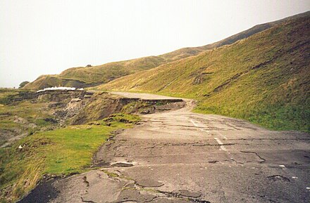 Mam Tor road destroyed by subsidence and shear, near Castleton, Derbyshire. SubsidedRoad.jpg