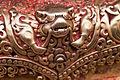 Swayambhunath, Statue Detail (5202519128).jpg