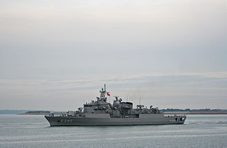 Turkish Naval Forces - Turkish frigate F-245 TCG ''Oruç Reis'' departing from Portsmouth Naval Base in the United Kingdom, on September 21, 2009. Off the bows in the distance is Fort Gilkicker, and beyond (to the left) the Isle of Wight.