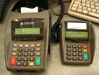 Payment terminal - An older generation Ingenico credit card terminal and separate keypad from 2006