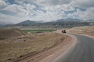 Tagab District, Kapisa - A humvee of the Afghan National Army traverses a solitary road through the Tagab Valley.