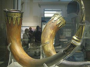 Taplow burial - Pair of drinking horns, made from aurochs horns with silver-gilt mounts.