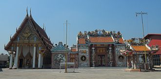 Religion in Thailand - A Thai Theravada Buddhist temple  (left) and a Chinese folk religion temple (right), side by side, showing the Thai and Chinese religious heritage of the country.