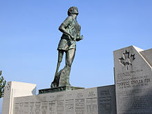 Statue of a runner with an artificial leg looking skyward.