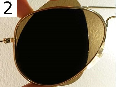 One can test whether sunglasses are polarized by looking through two pairs, with one perpendicular to the other. If both are polarized, all light will be blocked. Test for polarized and non-polarized sunglasses 2.jpg